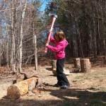 Ava Mae chopping wood